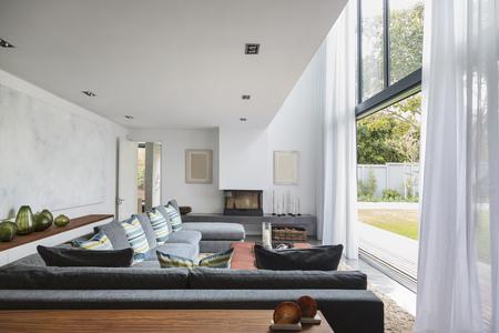 sectional door: Home showcase interior living room open to garden