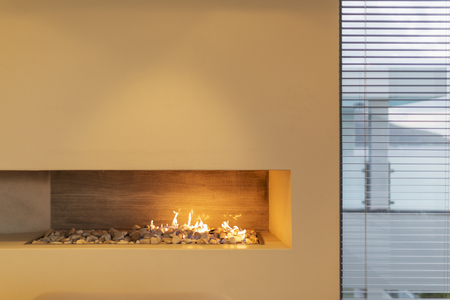 gas fireplace: Modern rock gas fireplace in home showcase interior
