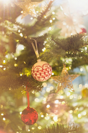 faerie: Red, white and gold ornaments hanging from Christmas tree