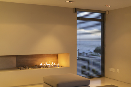 gas fireplace: Modern rock gas fireplace in home showcase living room LANG_EVOIMAGES