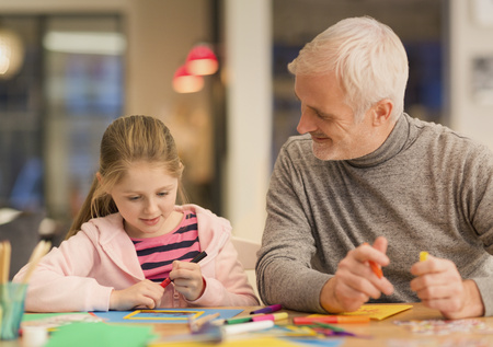 waist down: Father and daughter bonding,doing crafts at table