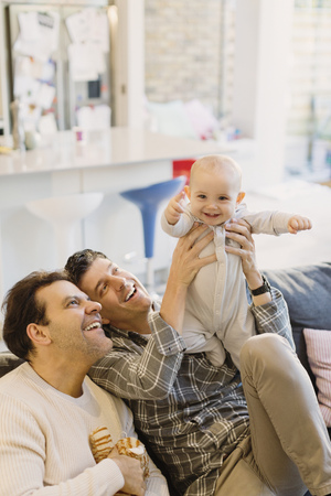 adult sex: Portrait playful cute baby son with male gay parents