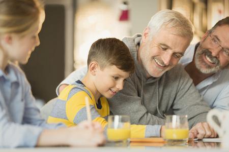 adult sex: Male gay parents and children using digital tablet LANG_EVOIMAGES