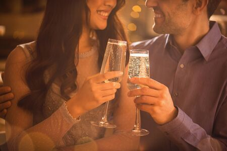 alcohol series: Affectionate couple toasting champagne flutes LANG_EVOIMAGES