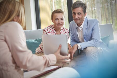 Therapist showing digital tablet to couple in couples therapy counseling session