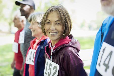 Portrait smiling, confident active senior woman at sports race starting line LANG_EVOIMAGES