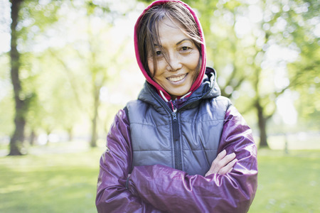 Portrait smiling, confident active senior woman in park