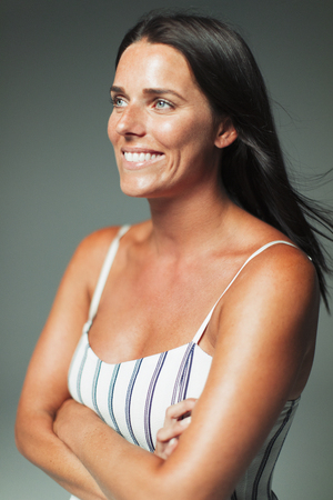 Portrait smiling, confident woman looking away