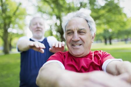 Active senior men exercising in park LANG_EVOIMAGES
