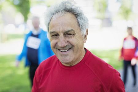 Portrait smiling, confident senior man in park