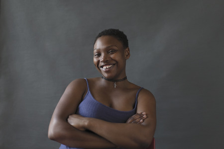 Portrait smiling, confident woman with arms crossed