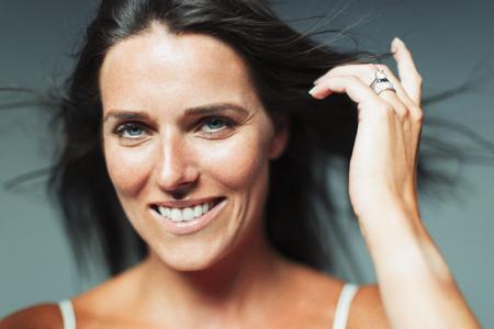 Portrait smiling, confident woman LANG_EVOIMAGES