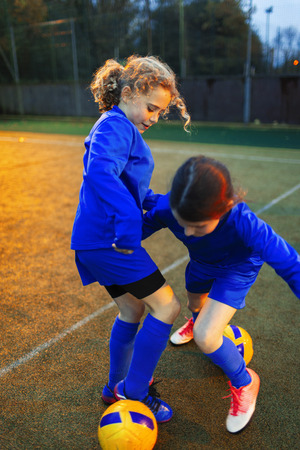 Girl soccer players practicing on field