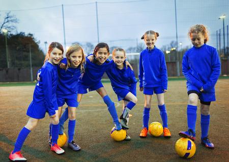 Portrait confident girls soccer team
