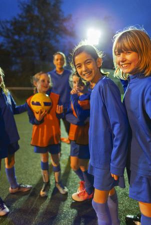 Portrait smiling, confident girls soccer team