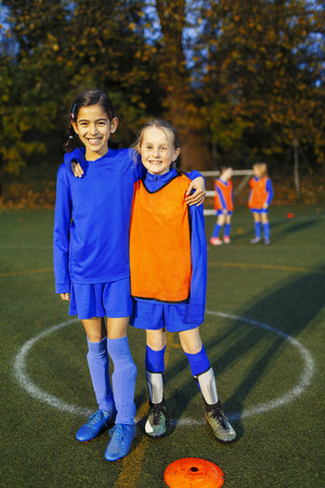 Portrait smiling, confident girl soccer players LANG_EVOIMAGES