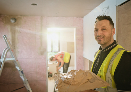 Portrait confident construction worker plastering