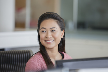 Portrait smiling, confident businesswoman in office
