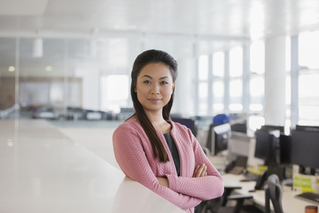 Portrait confident, ambitious businesswoman in office