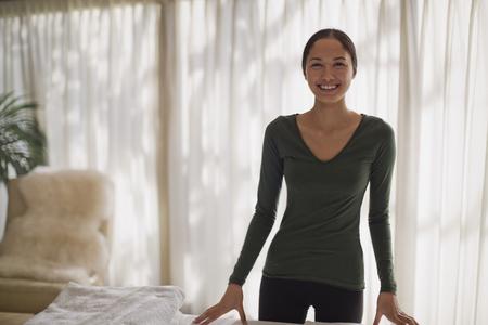 Portrait confident female masseuse