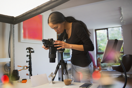 Female photographer working in studio LANG_EVOIMAGES