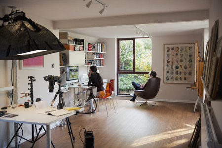 Couple working and reading in home office