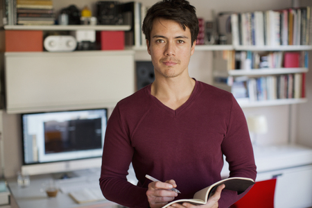 Portrait confident man working in home office