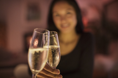 Personal perspective couple toasting champagne flutes
