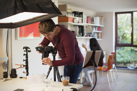 Male photographer working in studio LANG_EVOIMAGES