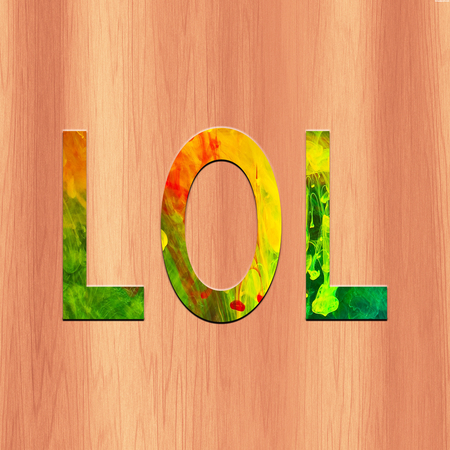 Colorful Text LOL in wood  background Stock Photo