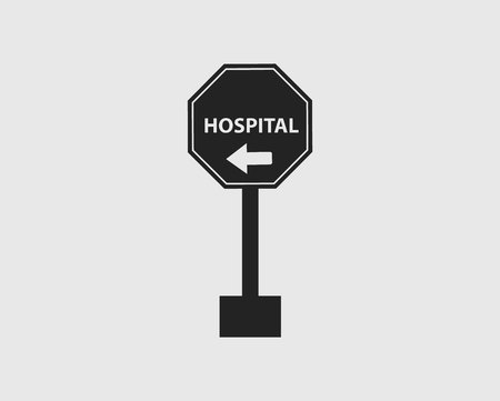 Hospital in Left Sign of Highway with gray Background.