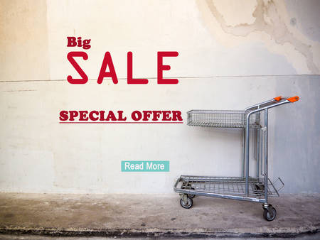 shopping cart: Sale signage with shopping cart Stock Photo