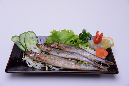 Shishamo Yaki , Grilled  Spirinchus , Traditional Japanese food isolated on white background Stock Photo