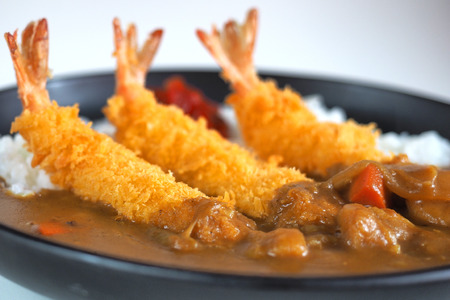 Ebi Fried Curry Rice , Deep Fried Prawn with Japanese Curry style on rice , selective focus point Stock Photo