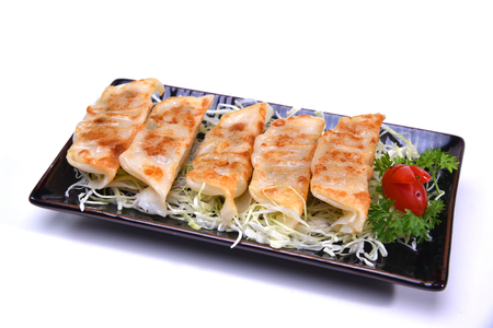 Japanese Pan Fried Dumplings , Gyoza isolated on white background (with clipping path) Stock Photo