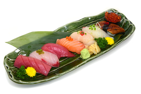 Sushi Set assorted nigiri platter on plate white background with Clipping path Stock Photo