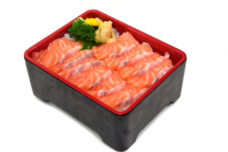 Salmon don Rice box : fresh sliced Salmon Sashimi on Rice Box isolated on white background with Clipping path