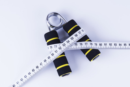 Diet Concept - Grip and Tape Measure Stock Photo