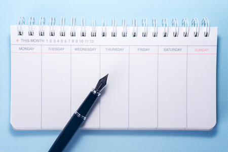 appointment book: Scheduler and Fountain Pen Stock Photo