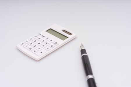 Calculator, computer keyboard and fountain pen