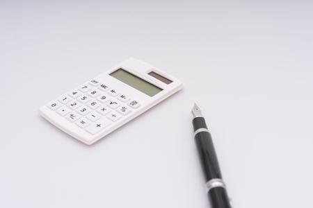 Calculator, computer keyboard and fountain pen
