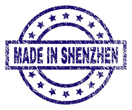 MADE IN SHENZHEN stamp seal watermark with distress texture. Designed with rectangle, circles and stars. Blue vector rubber print of MADE IN SHENZHEN caption with corroded texture.