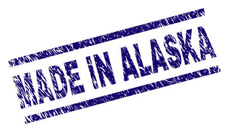 MADE IN ALASKA stamp seal watermark with distress style. Blue vector rubber print of MADE IN ALASKA text with dirty texture. Text label is placed between parallel lines.