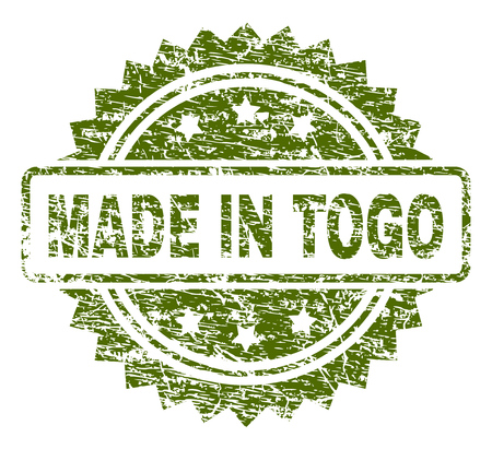 MADE IN TOGO stamp seal watermark with rubber print style. Green vector rubber print of MADE IN TOGO caption with retro texture. Illustration