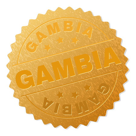 GAMBIA gold stamp award. Vector gold medal with GAMBIA text. Text labels are placed between parallel lines and on circle. Golden surface has metallic structure.