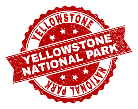 YELLOWSTONE NATIONAL PARK seal stamp with corroded texture. Rubber seal imitation has round medallion shape and contains ribbon.
