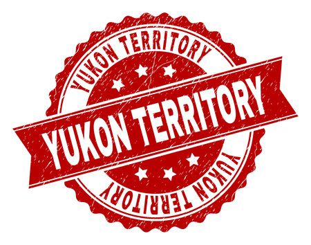 YUKON TERRITORY seal print with distress texture. Rubber seal imitation has circle medal form and contains ribbon. Red vector rubber print of YUKON TERRITORY caption with retro texture.