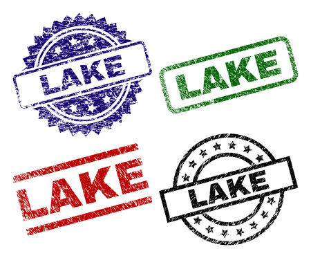 LAKE seal stamps with damaged style. Black, green,red,blue vector rubber prints of LAKE title with grunge style. Rubber seals with circle, rectangle, medallion shapes.