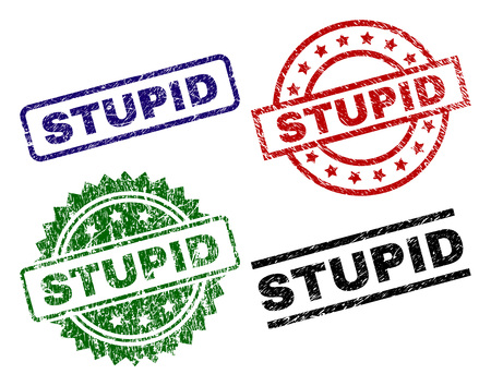 STUPID seal stamps with damaged surface. Black, green,red,blue vector rubber prints of STUPID label with grunge surface. Rubber seals with round, rectangle, medallion shapes.