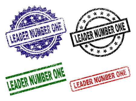 LEADER NUMBER ONE seal prints with corroded texture. Black, green,red,blue vector rubber prints of LEADER NUMBER ONE text with dust texture. Rubber seals with round, rectangle, rosette shapes.